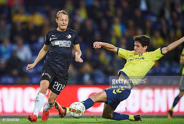 Joel Allansson of Randers FC and Christian Norgaard of Brondby IF compete for the ball during the Danish Alka Superliga match between Brondby IF and...
