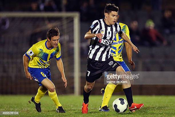 Joel Allwright of Adelaide runs with the ball during the FFA Cup match between Adelaide City and the Brisbane Strikers at the on September 16 2014 in...