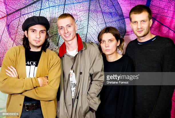 Joel Amey Theo Ellis Ellie Rowsel land Joff Oddie of Wolf Alice pose backstage after performing live instore and meeting fans signing copies of their...