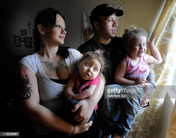 Joel and Nikki Easterly far left with their daughters Marisa left and Mila are pictured April 13 at their York Pennsylvania home The young couple is...