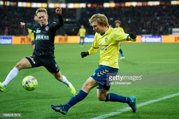 Joel Andersson of FC Midtjylland and Simon Tibbling of Brondby IF compete for the ball during the Danish Superliga match between FC Midtjylland and...