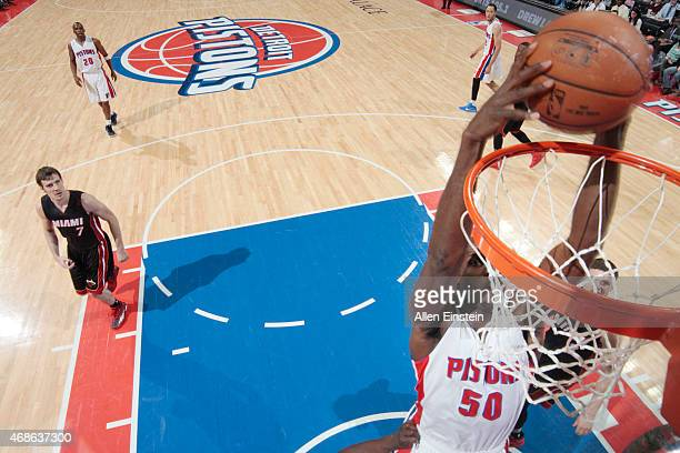 Joel Anthony of the Detroit Pistons dunks against the Miami Heat during the game on April 4 2015 at The Palace of Auburn Hills in Auburn Hills...