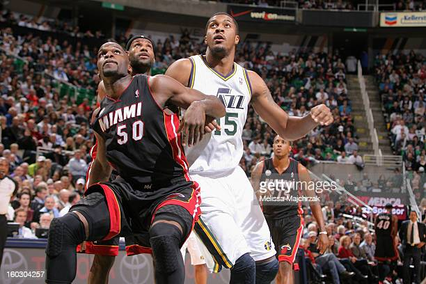 Joel Anthony of the Miami Heat battles for positioning against Derrick Favors of the Utah Jazz at Energy Solutions Arena on January 14 2013 in Salt...
