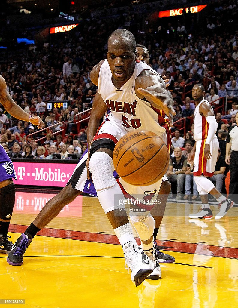 Joel Anthony #50 of the Miami Heat dives for a loose ball during a game against the Sacramento Kings at American Airlines Arena on February 21, 2012 in Miami, Florida.
