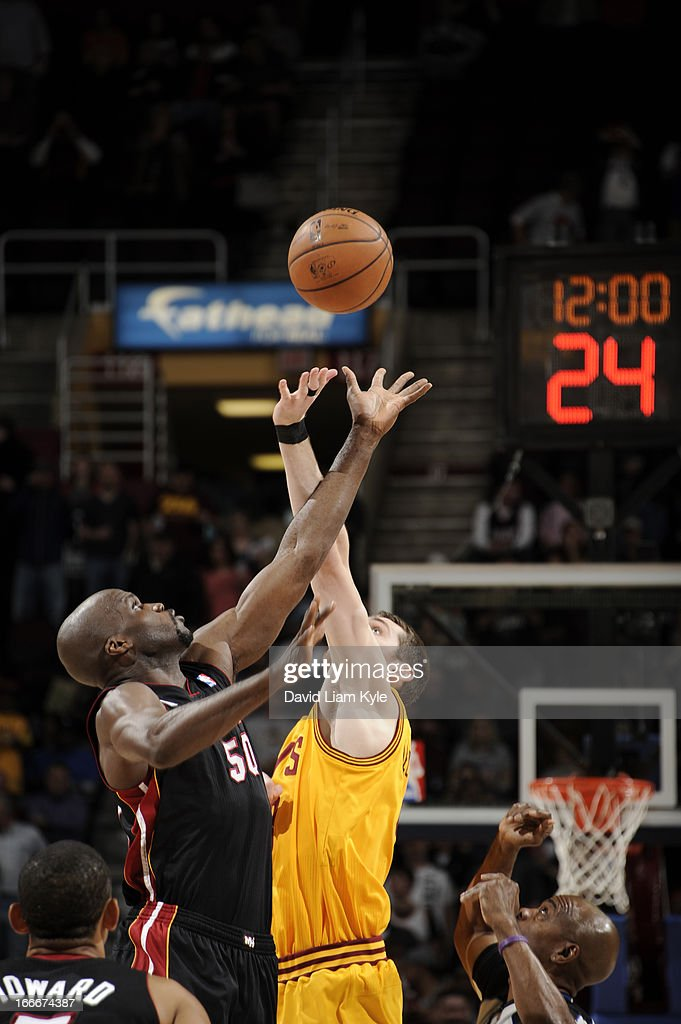 Joel Anthony #50 of the Miami Heat goes up for the opening tip off against Tyler Zeller #40 of the Cleveland Cavaliers at The Quicken Loans Arena on April 15, 2013 in Cleveland, Ohio.