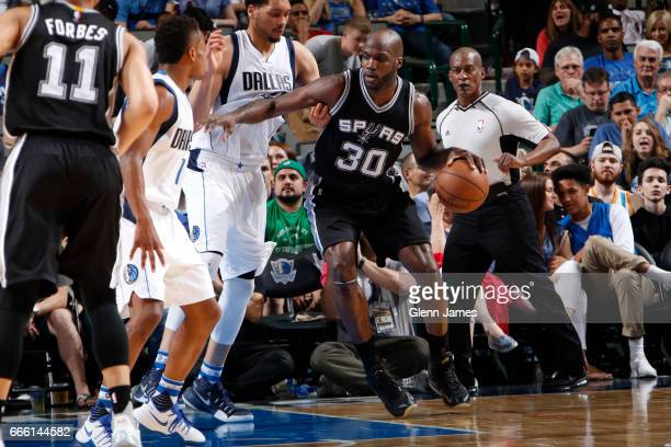 Joel Anthony of the San Antonio Spurs drives to the basket against the Dallas Mavericks on April 7 2017 at the American Airlines Center in Dallas...