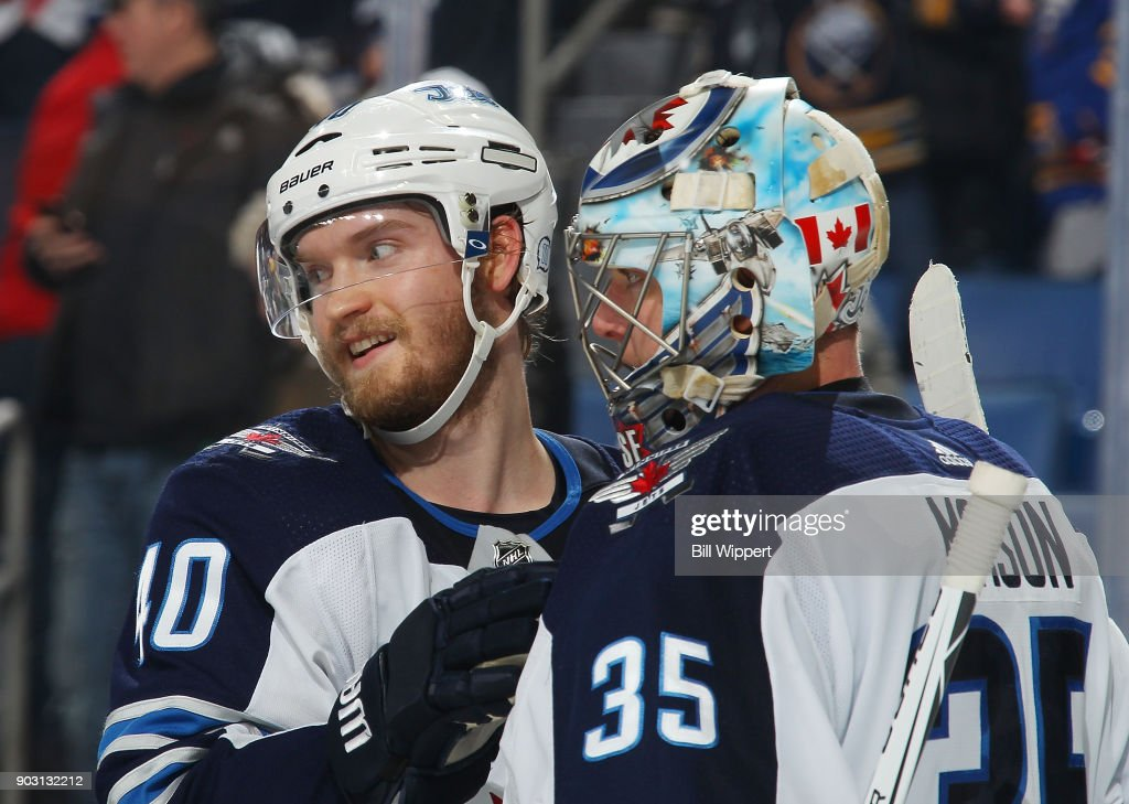 Joel Armia #40 and Steve Mason #35 of the Winnipeg Jets celebrate their 7-4 win over the Buffalo Sabres in an NHL game on January 9, 2018 at KeyBank Center in Buffalo, New York.
