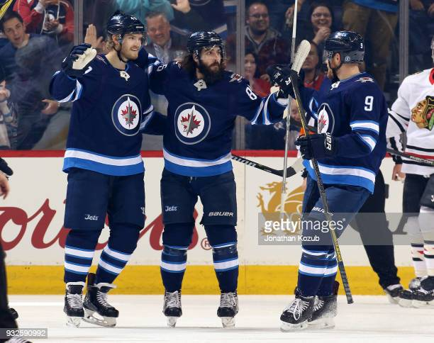 Joel Armia Mathieu Perreault and Andrew Copp of the Winnipeg Jets celebrate a first period goal against the Chicago Blackhawks at the Bell MTS Place...