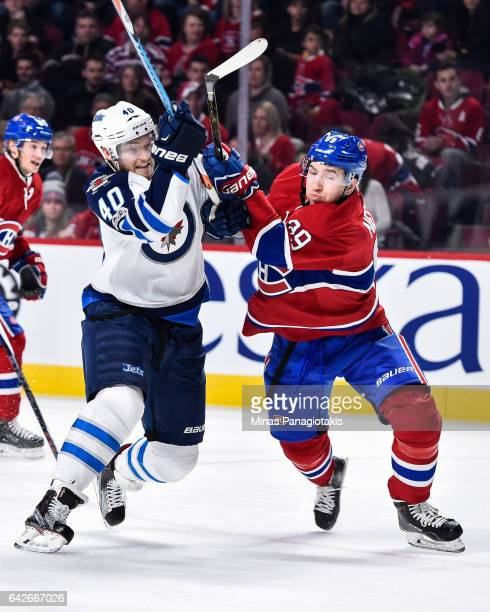 Joel Armia of the Winnipeg Jets and Nikita Nesterov of the Montreal Canadiens battle for position during the NHL game at the Bell Centre on February...