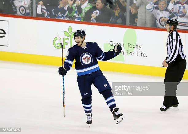 Joel Armia of the Winnipeg Jets celebrates his first period goal against the Pittsburgh Penguins at the Bell MTS Place on October 29 2017 in Winnipeg...