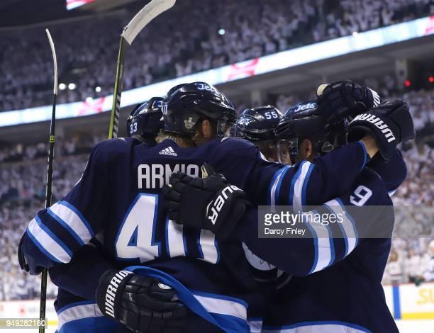Joel Armia of the Winnipeg Jets celebrates his first period goal against the Minnesota Wild with teammates Dustin Byfuglien Mark Scheifele and Andrew...