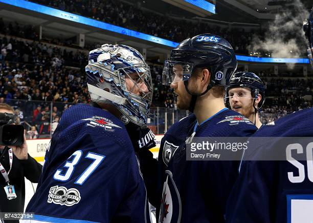 Joel Armia of the Winnipeg Jets congratulates goaltender Connor Hellebuyck after backstopping the Jets to a 41 victory over the Arizona Coyotes at...