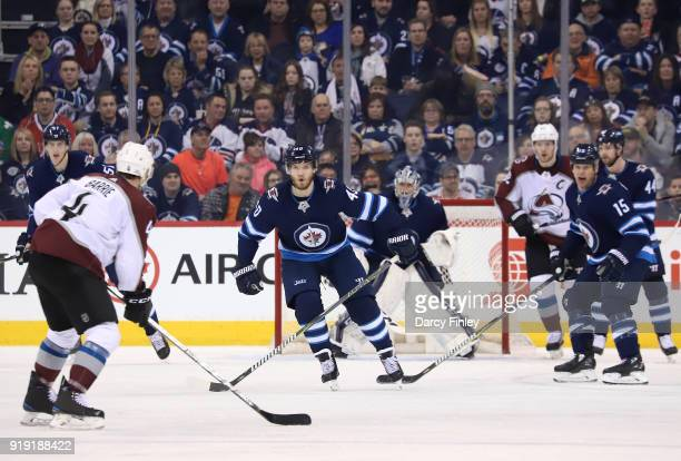 Joel Armia of the Winnipeg Jets defends as Tyson Barrie of the Colorado Avalanche plays the puck at the point during second period action at the Bell...