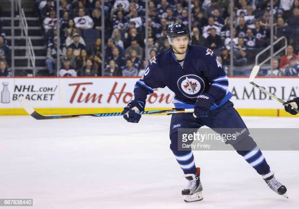Joel Armia of the Winnipeg Jets follows the play down the ice during second period action against the Nashville Predators at the MTS Centre on April...