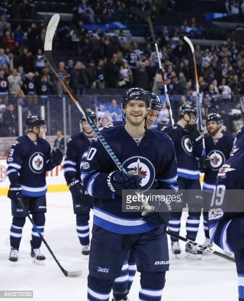 Joel Armia of the Winnipeg Jets is all smiles as the team salutes the fans following a 52 victory over the Dallas Stars at the MTS Centre on February...