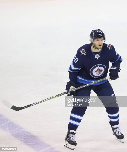 Joel Armia of the Winnipeg Jets keeps an eye on the play during first period action against the Washington Capitals at the Bell MTS Place on February...