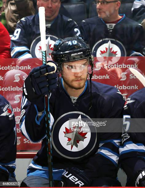Joel Armia of the Winnipeg Jets looks on from the bench prior to puck drop against the Colorado Avalanche at the MTS Centre on March 4 2017 in...