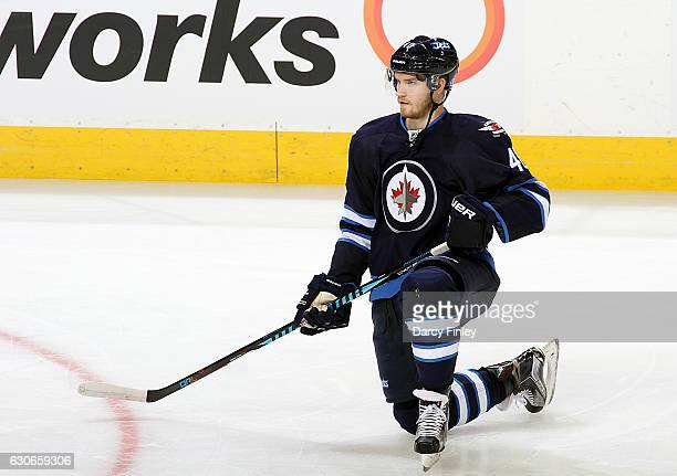 Joel Armia of the Winnipeg Jets stretches during the pregame warm up prior to NHL action against the Columbus Blue Jackets at the MTS Centre on...