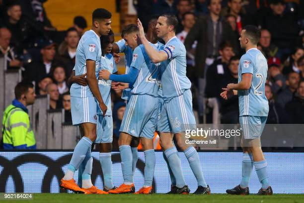 Joel Asoro of Sunderland celebrates with his team mates after scoring his team's first goal during the Sky Bet Championship match between Fulham and...