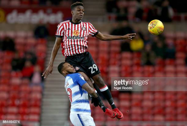 Joel Asoro of Sunderland challenged by Leandro Bacuna of Reading during the Sky Bet Championship match between Sunderland and Reading at Stadium of...