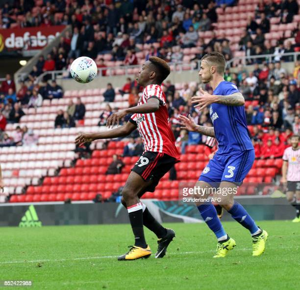 Joel Asoro of Sunderland holds the ball ahead of Joe Bennet of Cardiff during the Sky Bet Championship match between Sunderland and Cardiff City at...