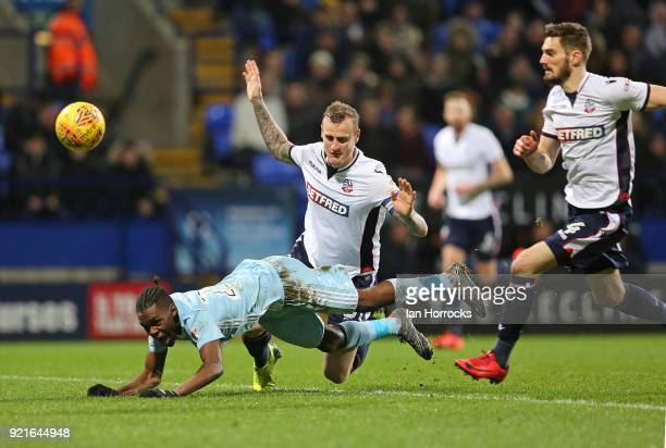Joel Asoro of Sunderland is brought down by David Wheater of Bolton during the Sky Bet Championship match between Bolton Wanderers and Sunderland at...
