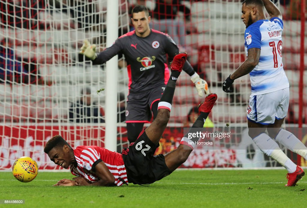 Joel Asoro of Sunderland is brought down leading to a penalty during the Sky Bet Championship match between Sunderland and Reading at Stadium of Light on December 2, 2017 in Sunderland, England.
