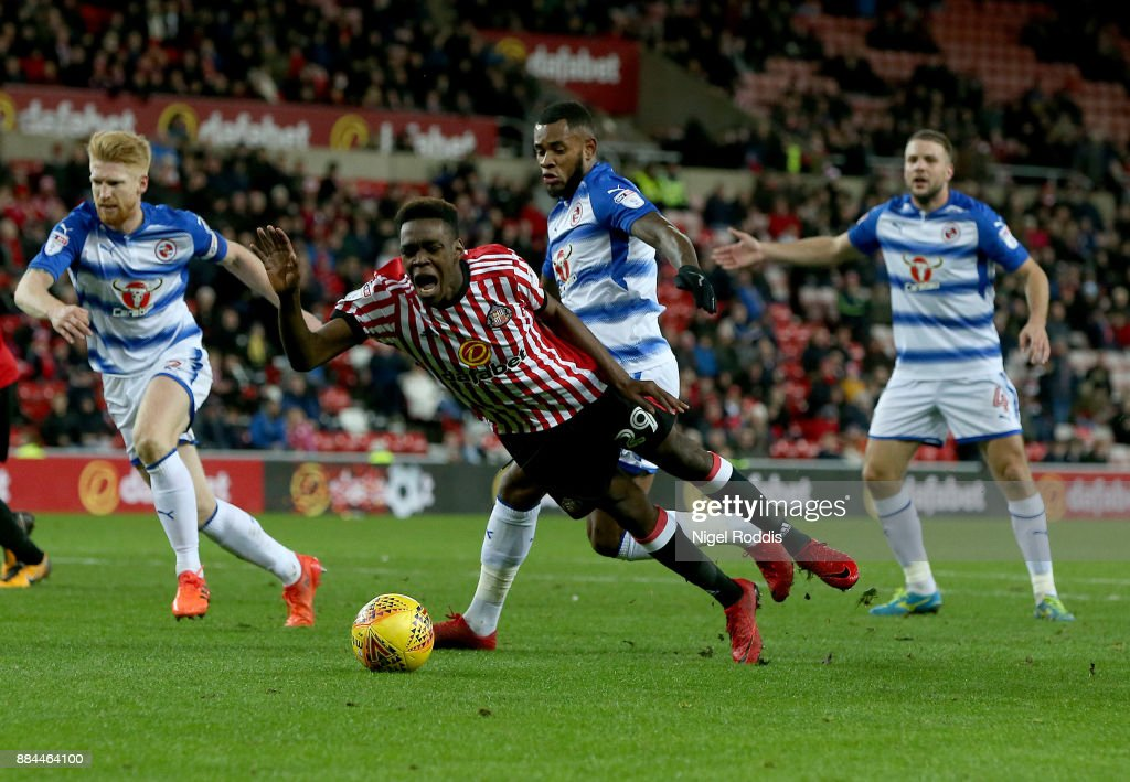 Joel Asoro (C) of Sunderland is fouled for a penalty by Leandro Bacuna (2ndR) of Reading during the Sky Bet Championship match between Sunderland and Reading at Stadium of Light on December 2, 2017 in Sunderland, England.