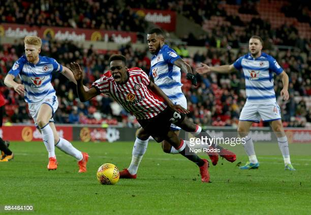 Joel Asoro of Sunderland is fouled for a penalty by Leandro Bacuna of Reading during the Sky Bet Championship match between Sunderland and Reading at...