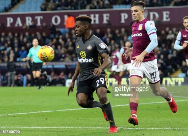 Joel Asoro of Sunderland shields the ball from Jack Grealish of Villa during the Sky Bet Championship match between Aston Villa and Sunderland at...