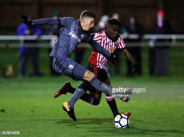 Joel Asoro of Sunderland takes on Mateusz Byra of Warsaw during the Premier League International Cup match between Sunderland and Legia Warsaw at...