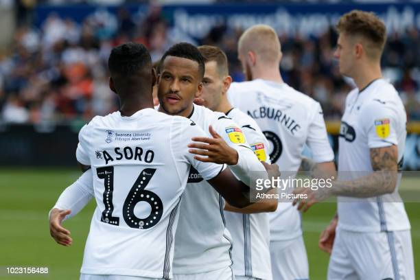 Joel Asoro of Swansea City is embraced by Martin Olsson prior to the Sky Bet Championship match between Swansea City and Bristol City at the Liberty...
