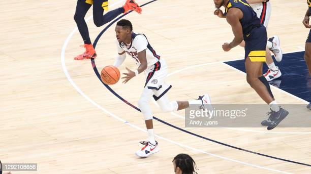Joel Ayayi of the Gonzaga Bulldogs dribbles the ball against the West Virginia Mountaineers during the Jimmy V Classic at Bankers Life Fieldhouse on...
