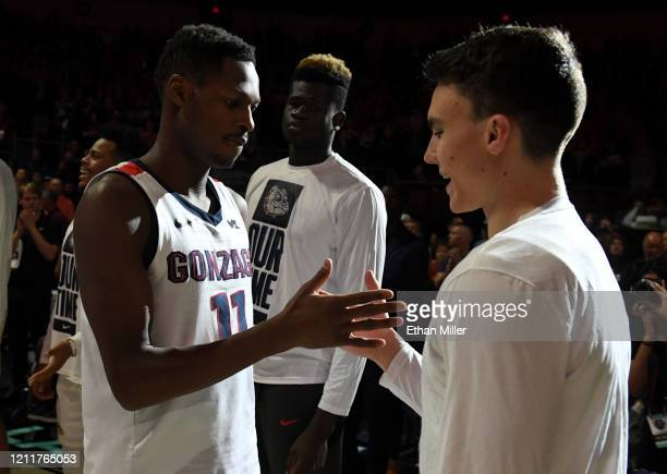 Joel Ayayi of the Gonzaga Bulldogs is greeted on the court by Matthew Lang during player introductions before taking on the Saint Mary's Gaels in the...