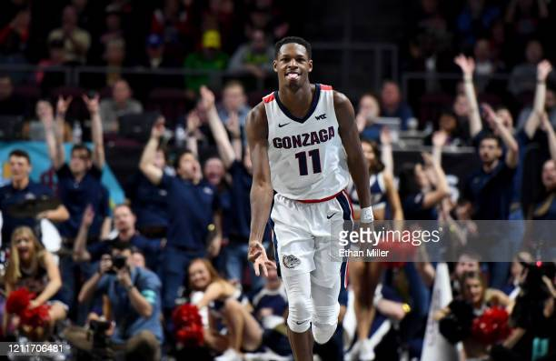 Joel Ayayi of the Gonzaga Bulldogs reacts after hitting a 3pointer against the Saint Mary's Gaels during the championship game of the West Coast...