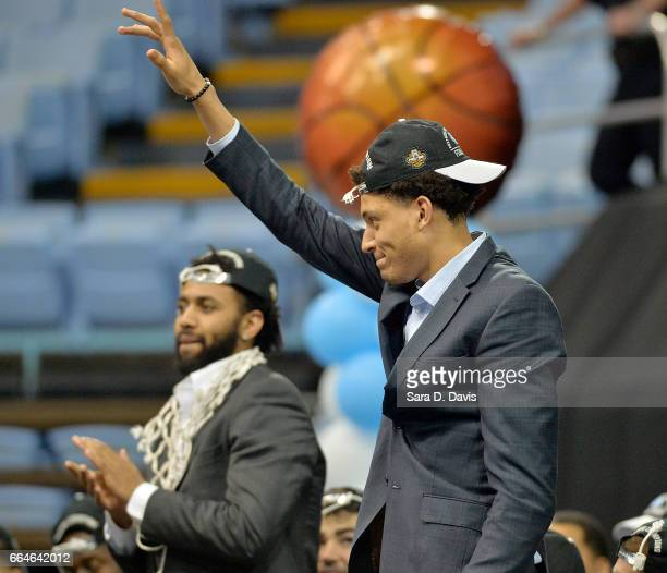 Joel Berry II and Justin Jackson of the North Carolina Tar Heels are recognized by having their jerseys retired during their welcomehome reception...