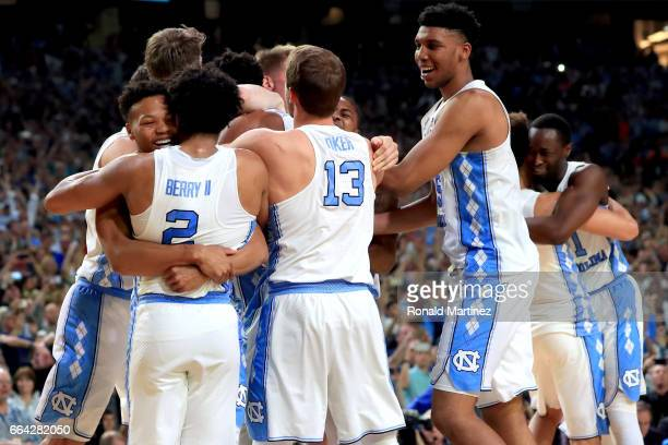 Joel Berry II Kanler Coker and Tony Bradley of the North Carolina Tar Heels celebrate with their team after defeating the Gonzaga Bulldogs during the...