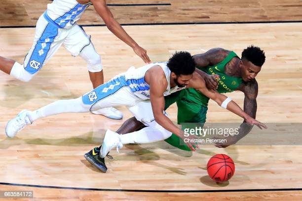 Joel Berry II of the North Carolina Tar Heels and Jordan Bell of the Oregon Ducks compete for a loose ball in the second half during the 2017 NCAA...
