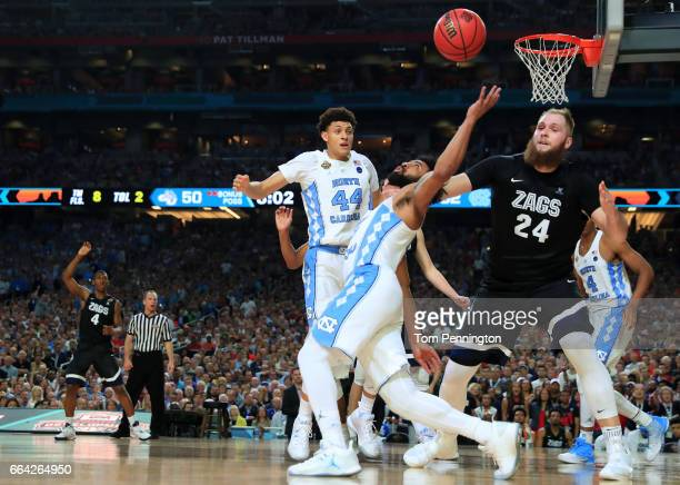 Joel Berry II of the North Carolina Tar Heels and Przemek Karnowski of the Gonzaga Bulldogs compete for the ball in the second half during the 2017...