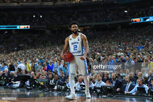 Joel Berry II of the North Carolina Tar Heels celebrates late in the game against the Gonzaga Bulldogs during the 2017 NCAA Men's Final Four National...