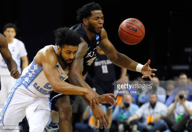 Joel Berry II of the North Carolina Tar Heels collides with Tyler Wideman of the Butler Bulldogs in the first half during the 2017 NCAA Men's...