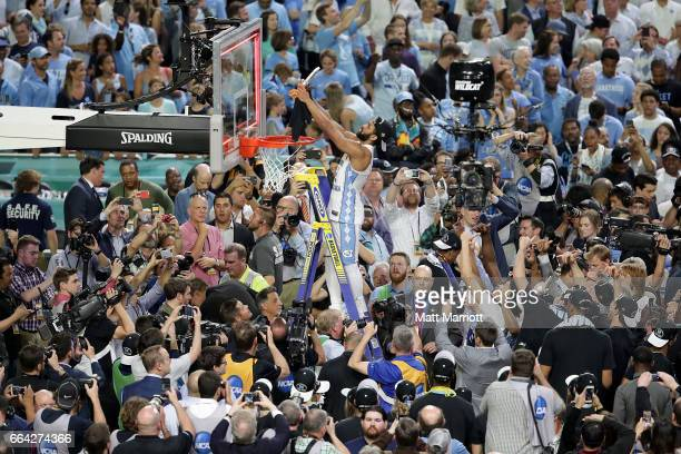 Joel Berry II of the North Carolina Tar Heels cuts a piece of the net during the 2017 NCAA Men's Final Four National Championship game against the...
