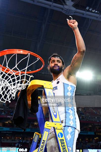 Joel Berry II of the North Carolina Tar Heels cuts the net during the 2017 NCAA Men's Final Four National Championship game against the Gonzaga...