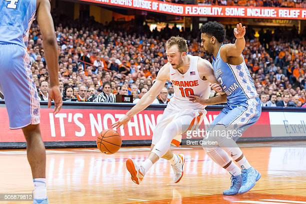 Joel Berry II of the North Carolina Tar Heels defends as Trevor Cooney of the Syracuse Orange drives to the basket on January 9 2016 at The Carrier...