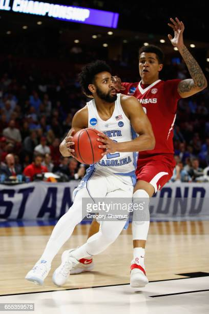 Joel Berry II of the North Carolina Tar Heels dribbles against Dustin Thomas of the Arkansas Razorbacks in the first half during the second round of...