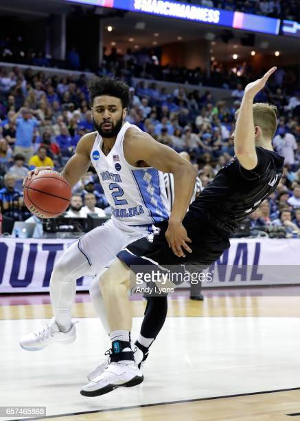 Joel Berry II of the North Carolina Tar Heels dribbles around Tyler Lewis of the Butler Bulldogs in the first half during the 2017 NCAA Men's...