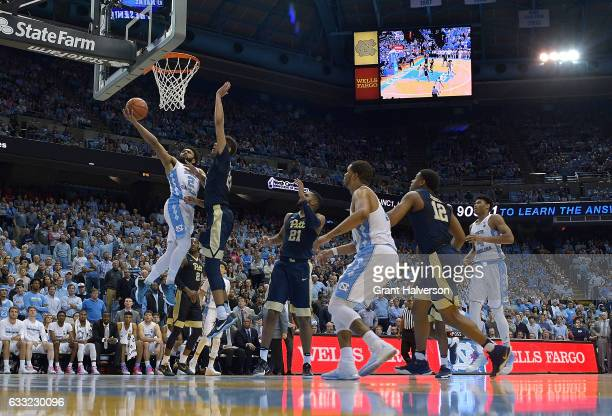 Joel Berry II of the North Carolina Tar Heels drives against Cameron Johnson of the Pittsburgh Panthers during the game at the Dean Smith Center on...