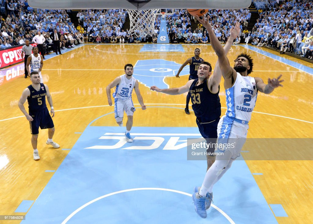 Joel Berry II #2 of the North Carolina Tar Heels drives against John Mooney #33 of the Notre Dame Fighting Irish during their game at the Dean Smith Center on February 12, 2018 in Chapel Hill, North Carolina. North Carolina won 83-66.