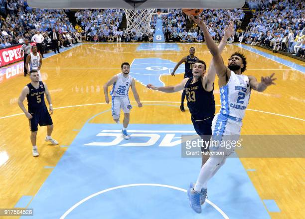 Joel Berry II of the North Carolina Tar Heels drives against John Mooney of the Notre Dame Fighting Irish during their game at the Dean Smith Center...