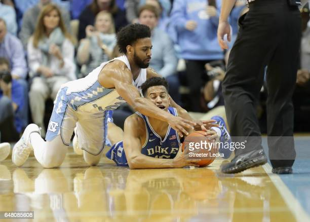 Joel Berry II of the North Carolina Tar Heels goes after a loose ball against Frank Jackson of the Duke Blue Devils during their game at the Dean...